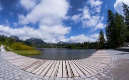Strbske pleso landing stage. A broad view on thewooden landing stage at Strbske pleso lake with a hotel in background stock photos