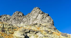 Strbske Pleso, Slovakia - October 17, 2018: Climbers while climbing in the Tatra mountains on a climbing route called Plskova Cest royalty free stock photo