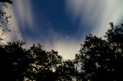 Streaked night sky with clouds and stars Royalty Free Stock Images
