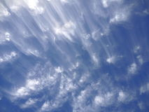Streaked, wispy clouds. Streaked clouds in a blue sky Stock Photography