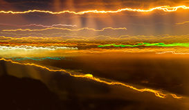 Streaks of coloured light. A long exposure from a moving plane transforms airport lights into streaks of colour Royalty Free Stock Images
