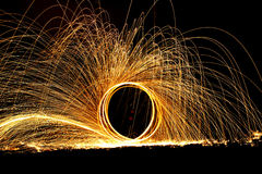 Twirling fire at night. Royalty Free Stock Photography