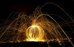 Designs of fire and long exposure. Streaks of fire from steel wool on fire during a long exposure night shot Royalty Free Stock Image