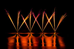 Streaks of Pink and Yellow Fireworks Stock Image