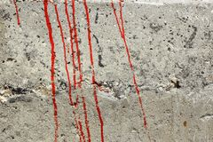Streaks of red paint on a concrete wall Stock Image