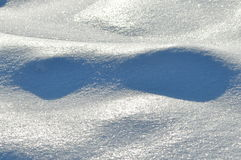 Streaks of snow. Snowflakes on the ice. Winter Stock Photography