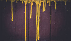 Streaks of yellow paint on dark brown Royalty Free Stock Photography