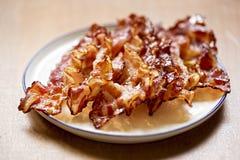 Streaky fried bacon rashers Stock Photos