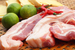 Streaky pork in the basket - for cooking. Royalty Free Stock Images