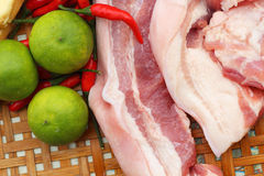 Streaky pork in the basket - for cooking. Stock Images