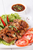 Streaky pork fried with spicy dipping sauce, Thai food Royalty Free Stock Images