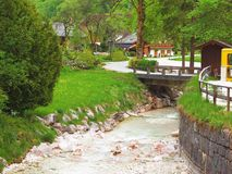 Stream in the Alpine village Stock Photography