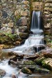 Stream in autumn Stock Images
