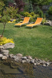 Stream with Backyard Chairs Royalty Free Stock Photos