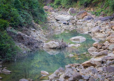 Stream bed in a valley Stock Image