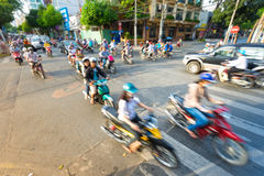Stream of bikes in busy street in Vietnam. Stock Photos
