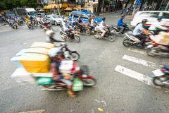 Stream of bikes in busy street in Vietnam. Royalty Free Stock Images