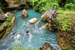 Stream Blue water. Flow from jung cave in vang vieng Laos Stock Photo