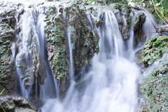 Stream blurred water in small waterfall Royalty Free Stock Image