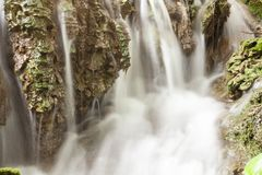 Stream blurred water in small waterfall Stock Photo