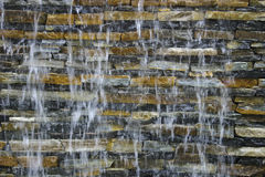 Stream on a brick wall. Stream of water on a decorative brick wall Stock Image