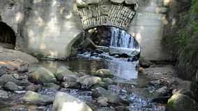 Stream brook water flow run stones old retro water mill arch stock video