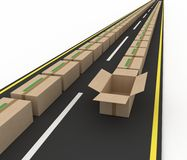 Stream of cardboard boxes on road Stock Photo