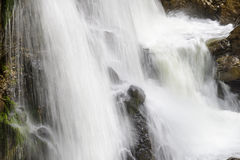 Stream with cascade in the mountains Stock Photography