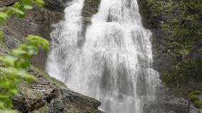 Stream with cascade in the mountains stock footage