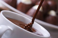 Stream chocolate being poured into a cup Stock Photos