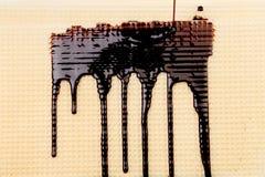 Stream chocolate on wafer. Close up. Stock Photos