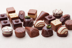 Stream of chocolates Stock Photos