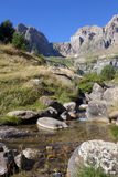 Stream of clear water in the mountains in Pyrenees Royalty Free Stock Image