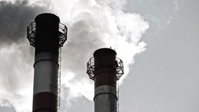 Stream of dark smoke from the chimney of factory. In the industrial district stock video footage