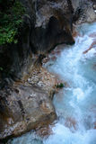 Stream in deep rocky ravine. Stream between rocks in deep ravine in mountains Royalty Free Stock Images