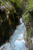 Stream in deep rocky ravine. Stock Photo