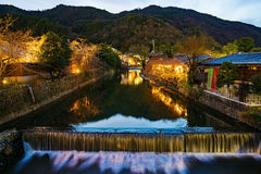 Stream at dusk in Kyoto. With traditional Japanese buildings Royalty Free Stock Image