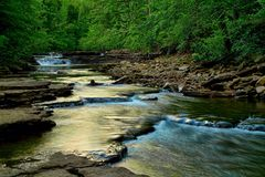 Stream of Faith. Rain water flows from the mountains to the valleys below Royalty Free Stock Images