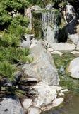 Stream and falls among greens. Japanese garden, landscape. Stock Photos