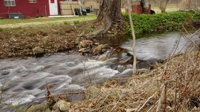 A Stream With Wispy Water Flowing. A stream of fast moving water slowed town by a slow shutter to give it an artistic affect Royalty Free Stock Photo