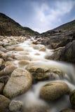Stream feeding onto Porth Nanven beach Stock Photo