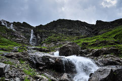 Stream Flowing Across Mountains In Tibet Stock Image