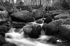 Stream flowing around the rocks in Keniveil. A long exposure of a stream wrapping around the rocks in Keniveil, Falmouth, Cornwall, england Stock Photo