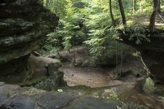 Stream flowing through gorge stock photography