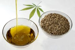 A stream of flowing hemp seed oil royalty free stock photos