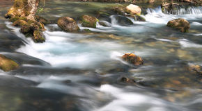 Stream flowing Stock Images