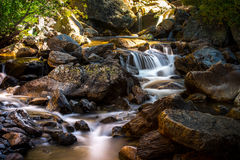 Stream Flowing Through Rocks Stock Images