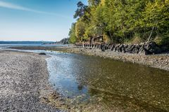 Coastal Stream. A stream flows into the Puget Sound at Normandy Park, Washington Royalty Free Stock Photography