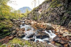 A stream flows through the rocks on the Isle of SKye. Beautiful Royalty free stock photo. A stream flows through the rocks on the Isle of SKye Stock Photo