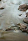 Stream flows through small rocks Royalty Free Stock Photography